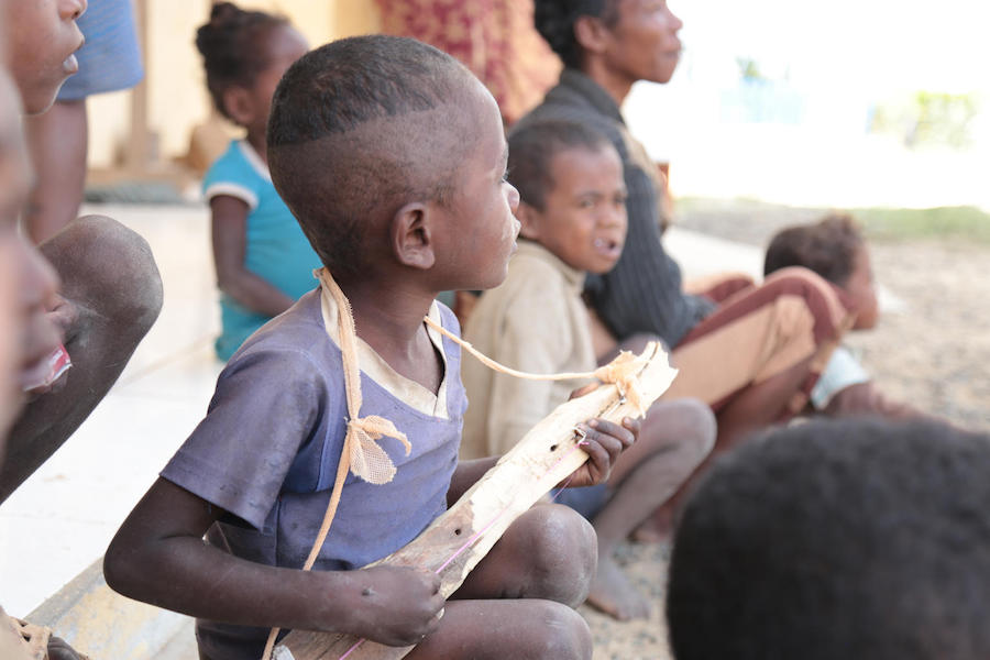 Bolo created his own toy, a music instrument, while waiting for his turn at the UNICEF-supported health center in Tsiombe, Madagascar in November 2018.