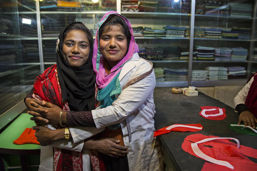 Jannatu, 17 (left), and Rajia, 18, are training to become tailors at a shop in Ukhiya, Bangladesh as part of a UNICEF-supported vocational skills program for young Rohingya refugees and young people in the surrounding communities.