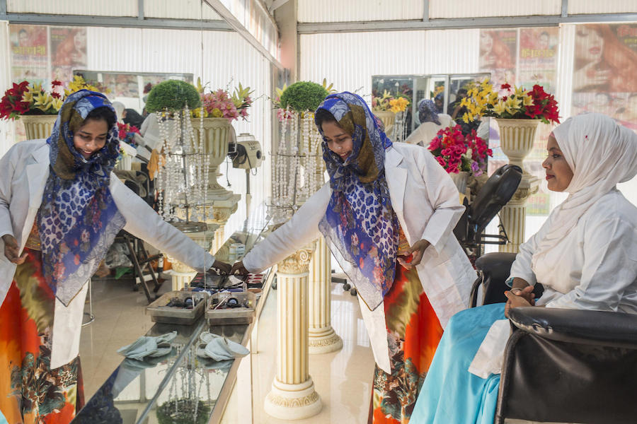 In February 2019 in Bangladesh, two  interns in a UNICEF-supported vocational program at a beauty parlor in Ukhiya in Cox's Bazar district.