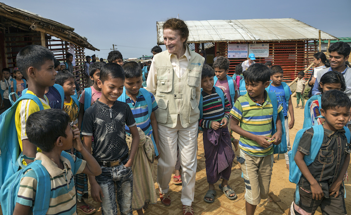 UNICEF Executive Director Henrietta H. Fore visits with Rohingya refugee children outside a learning center in the Kutupalong-Balukhali camp in Cox's Bazar, Bangladesh.