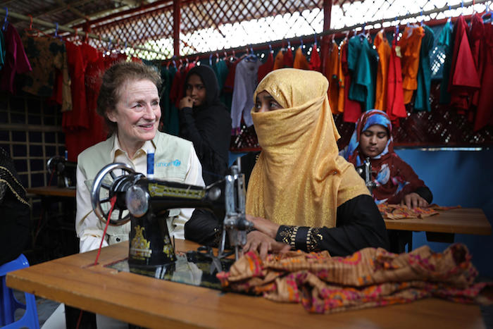 In February 2019 in Bangladesh, UNICEF Executive Director Henriette H. Fore receives a sewing lesson from Rafika, 25, a mother of four who is developing skills at the UNICEF-supported Safe Space for Women and Girls in a Rohingya refugee camp, Bangladesh.