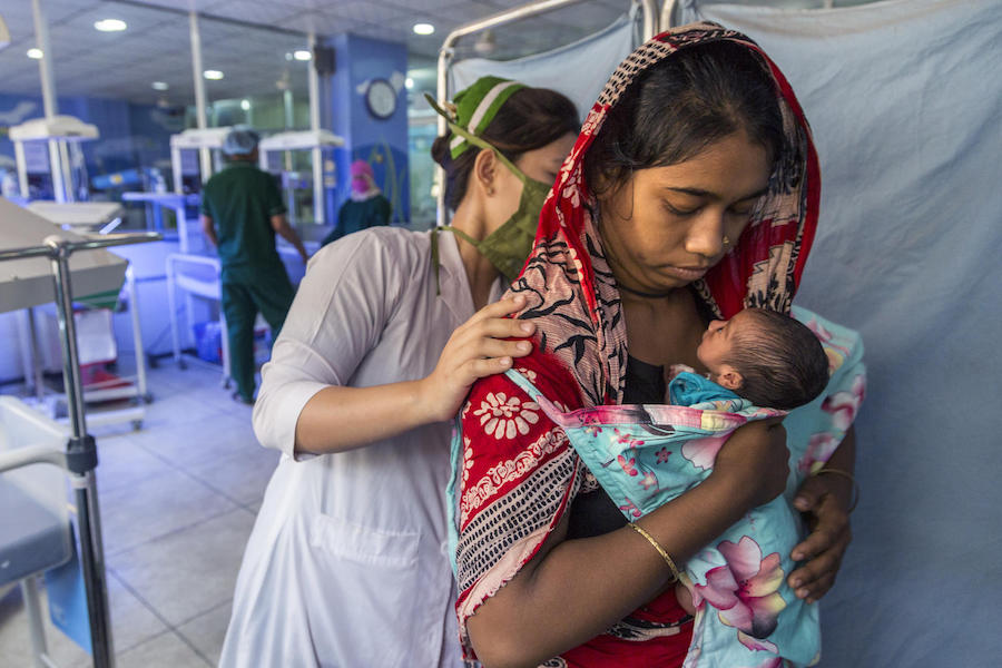 In February 2019, a newborn baby is tended by 19-year-old first-time mother Sharmin and a nurse at the UNICEF-supported Patuakhali Sadar Hospital in Cox's Bazar, Bangladesh.