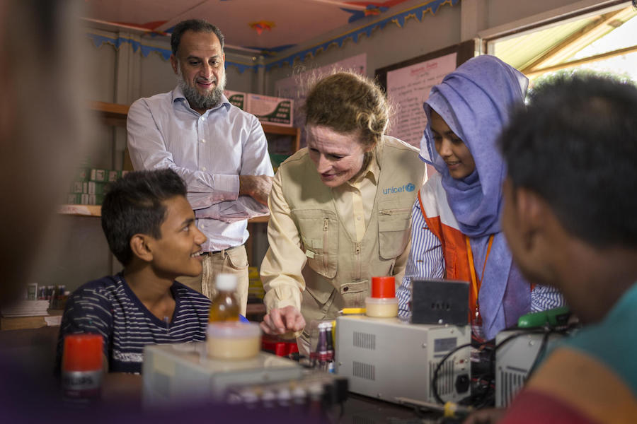 UNICEF Executive Director Henrietta H. Fore observes adolescents learning cellphone repair in a UNICEF-supported program at Tenkali Rohingya refugee camp in Cox's Bazar, Bangladesh  in February 2019.