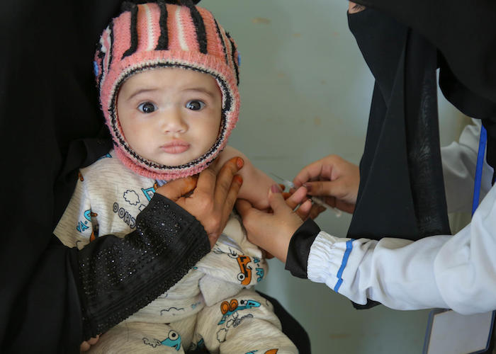 A child is vaccinated at a health center in Bani Alhareth, Sana'a, Yemen during a UNICEF-backed measles and rubella vaccination campaign in February 2019.