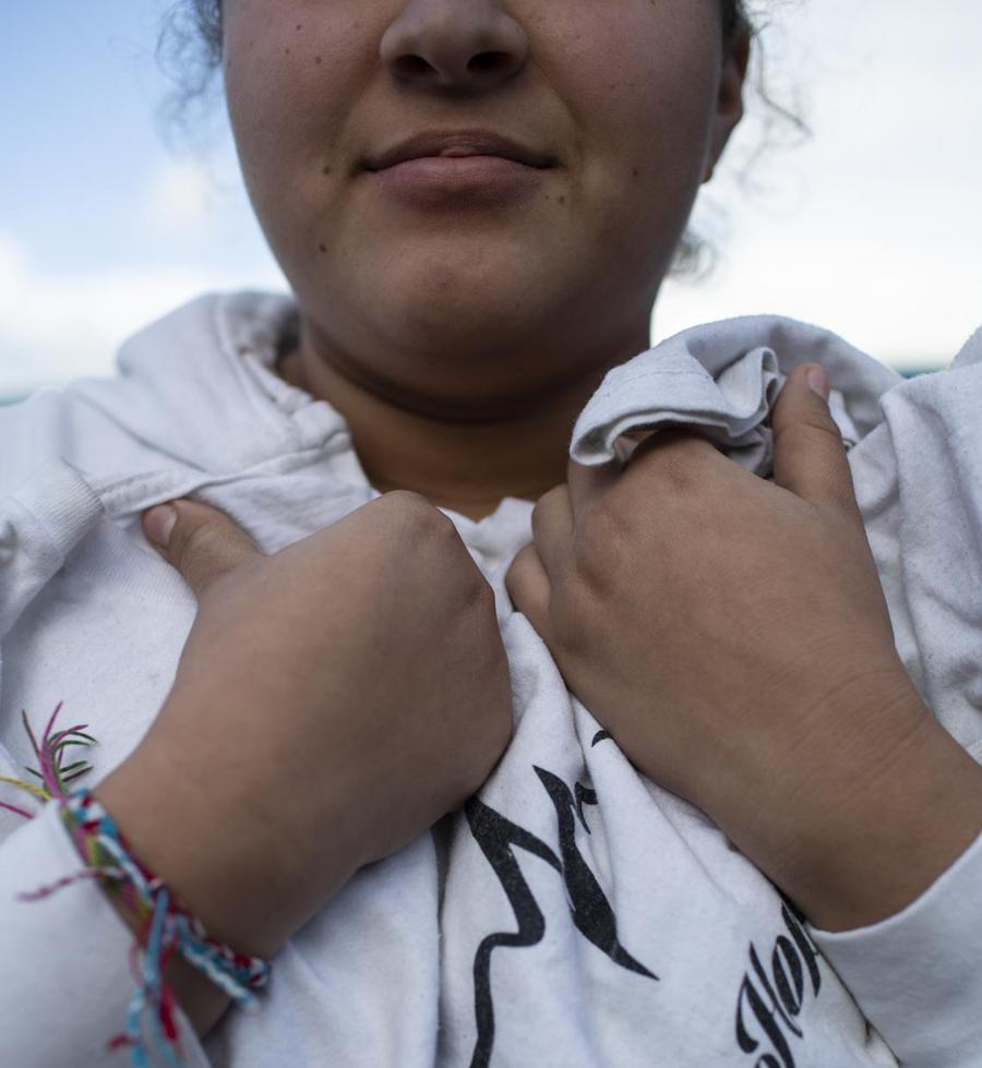 At a shelter for unaccompanied migrant adolescents in Tijuana, Mexico in February 2019, Kylie, 15, holds a T-shirt she won in a dance competition.