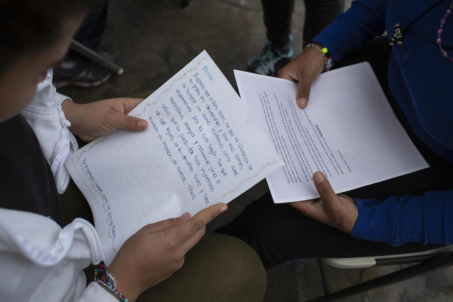 At a shelter for unaccompanied migrant adolescents in Tijuana, Mexico in February 2019, teenagers from Central America ready letters of support they received from Mexican teenagers.