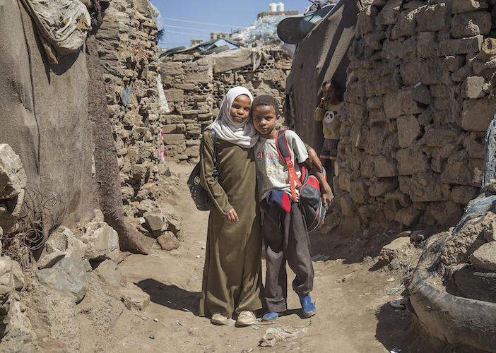Rania, 12, missed a year of school in Dar Salm, Yemen. Now in the sixth grade, she's tutoring her brother in math.