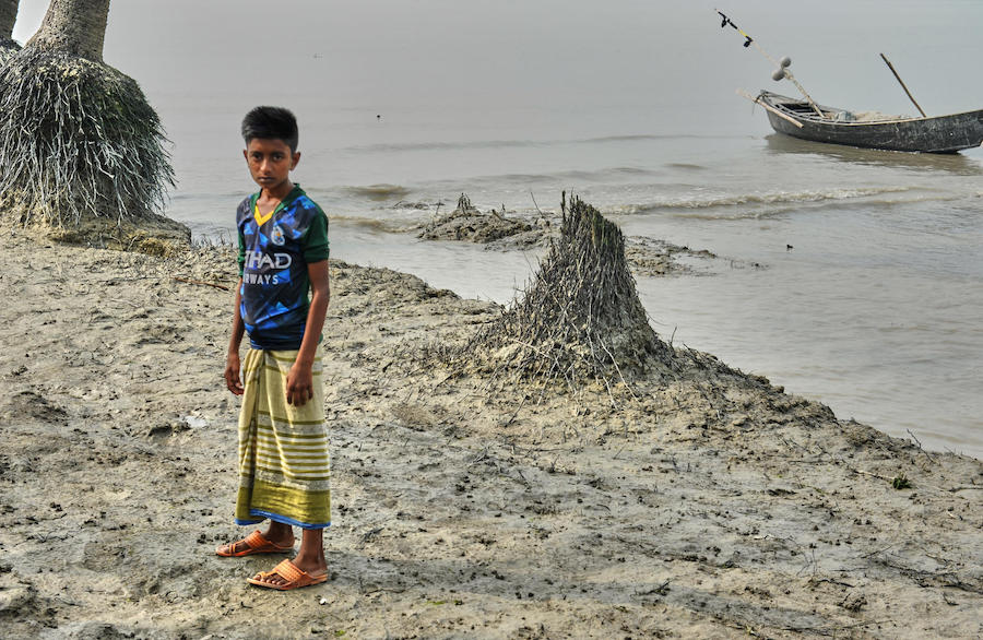 Maroof Hussein, 11, has vivid memories of the 2017 flood that killed his friend Iqbal in the village of Nizampur, Bangladesh on the fringe of the Bay of Bengal.