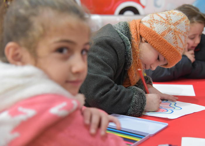 Five-year-old Fatme (center) enjoyed her first day of UNICEF-supported preschool in Aleppo, Syria in 2019.