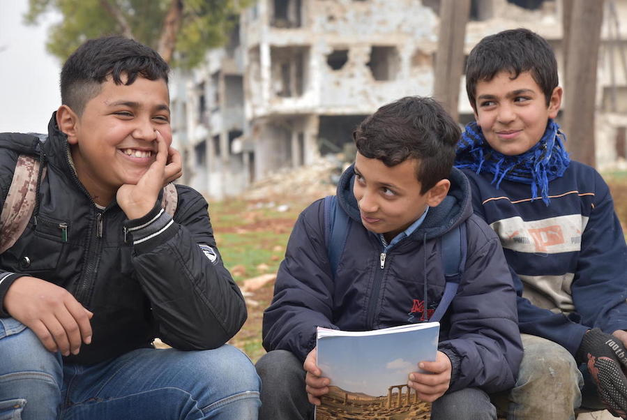 One out of three children in Syria are out of school. Hussein and Mohamed, left and center, go to school together in Aleppo, Syria, but their friend Mustafa, 12, does not.