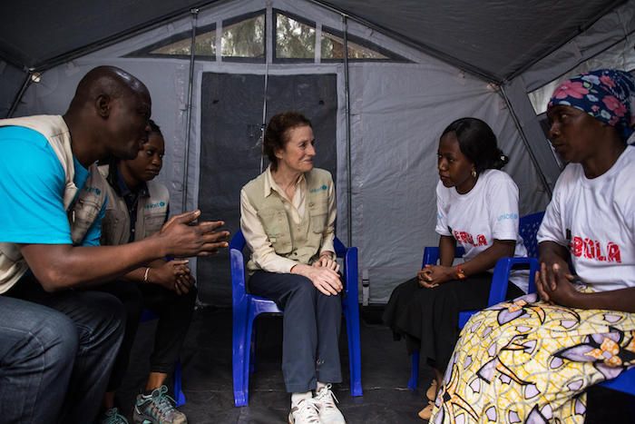 On 20 March 2019 in Butembo, Democratic Republic of the Congo, UNICEF Executive Director Henrietta H. Fore speaks with Fabiola Masika Mwengesyali (far right) and Huguette Mulyanza Vthya (black skirt), two Ebola survivors. Other UNICEF staff accompany them