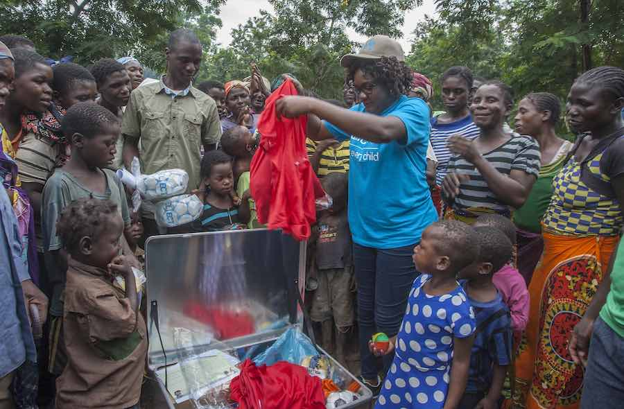 UNICEF Child Protection Officer Malla Mabona presents a Children's Specialist Sports Kit to children of Nyachilenda Camp for people displaced by floods at Nyachilenda Primary School in the area of Traditional Authority Ndamera in Nsanje District in Southe