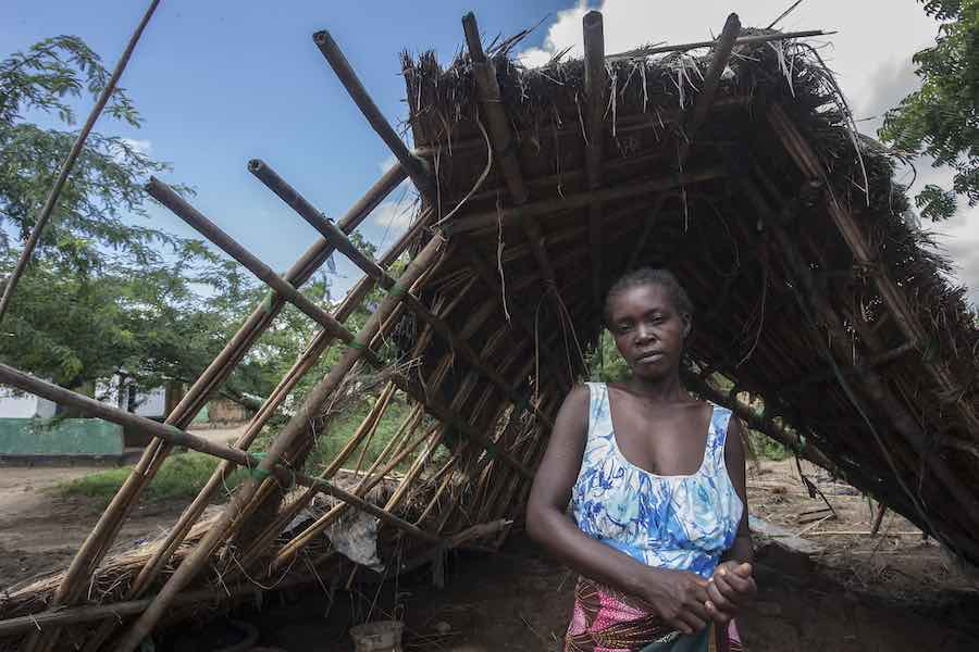 Having lost everything in Cyclone Idai, Anne stands near the wreckage of her former home. It will cost 30,000 kwacha [US $41.46] to rebuild.
