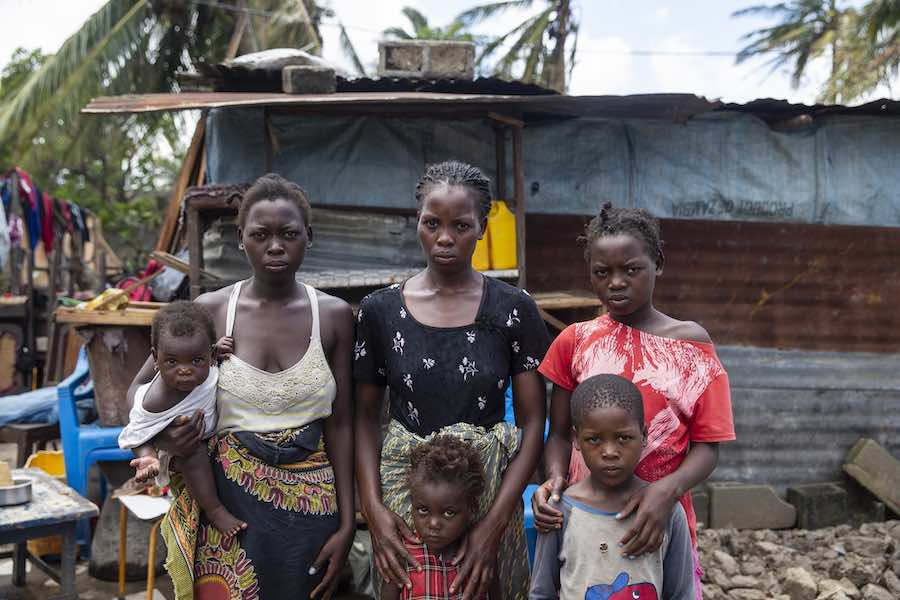 Anna Francesco holds her daughter Tina Fransesco, Clara Fransesco, Tija Fransesco, (bottom row) Regina Francesco and Emmanuel Francesco stands in front of a temporary shelter that they built in Beira. Their house was destroyed during Cyclone Idai. This f