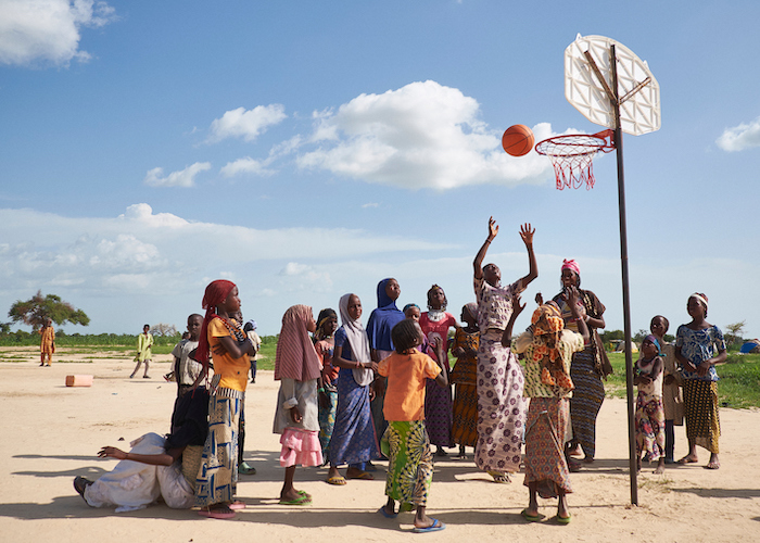 Girls play basketball at a displaced persons site in Ngagam, Niger on August 11, 2016. Recreational activities are set up by COOPI, an implementing partner of UNICEF. to create a sense of normalcy for children who have fled conflict.