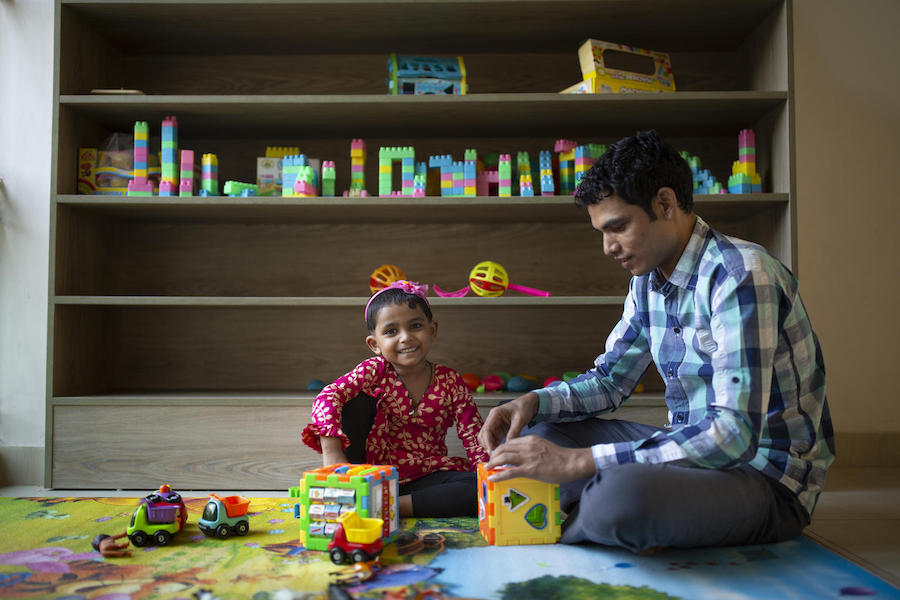 Jamal Hossain, 26, plays with his daughter Jui, 30 months, at the UNICEF-supported day care center at Northern Tosrifa Group garment factory where he works in Gazipur, outside Dhaka, Bangladesh.