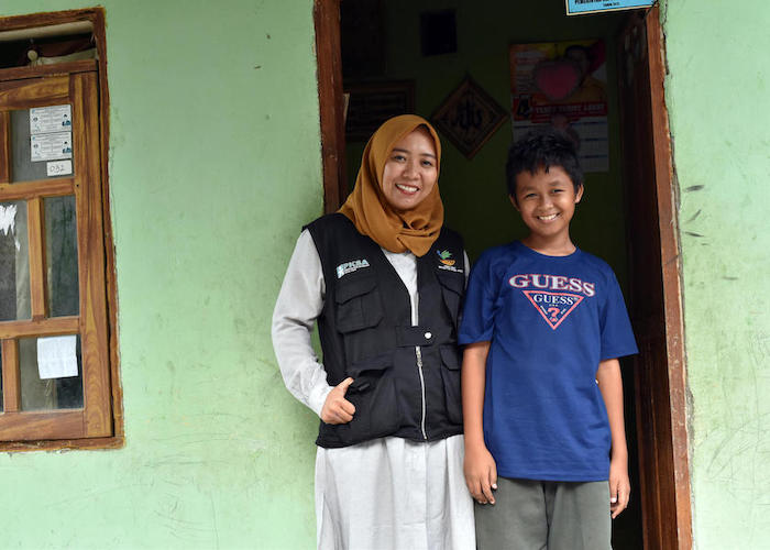 UNICEF-supported social worker Chi Ramadhani helped reunite Rivaldi, 13, with his family three days after an earthquake and tsunami hit Central Sulawesi, Indonesia in September 2018.