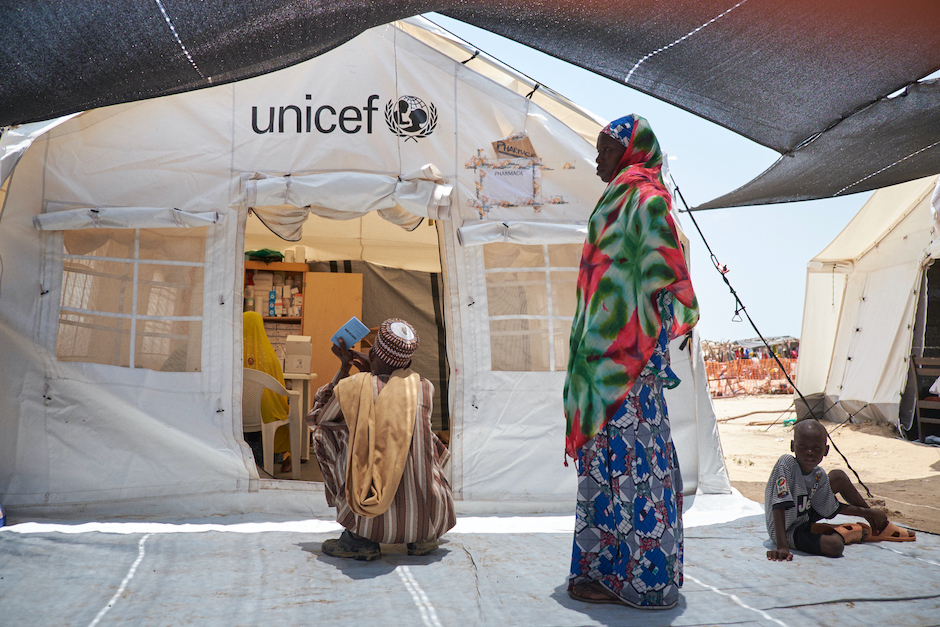 Patients wait for treatment at a UNICEF mobile health clinic in Garin Wazam, Diffa, Niger, where hundreds of thousands of people from around Lake Chad have fled to escape violence perpetrated by Boko Haram insurgents.