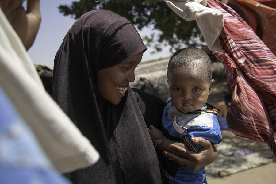 Hoodoo Said Hussein, 27, holds her 18-month-old son, Jimale, in Lasadawaco, Somaliland on March 5, 2019. Married when she was just 15, she dropped out of school after giving birth. She is now a student again, at a UNICEF-supported school.
