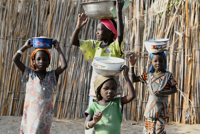 Children carry food in Bol, Chad, one of over 100 countries where UNICEF works to save and protect vulnerable children.