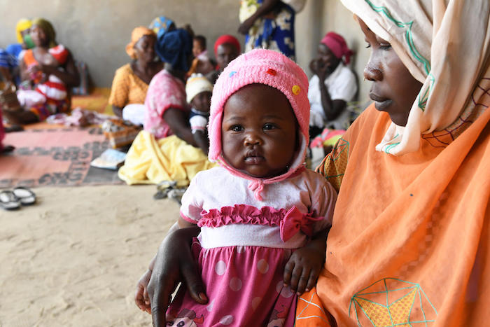 A mother and her baby daughter wait to be vaccinated at the UNICEF-supported health center in Ambatta, a suburb of Ndjamena, the capital of Chad, in 2019.