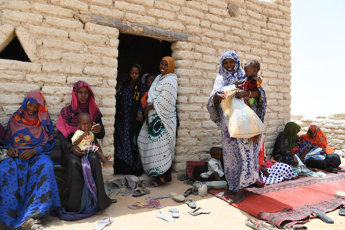Women and children wait outside the UNICEF-supported health center in Bolingo, in central Chad, in 2019.
