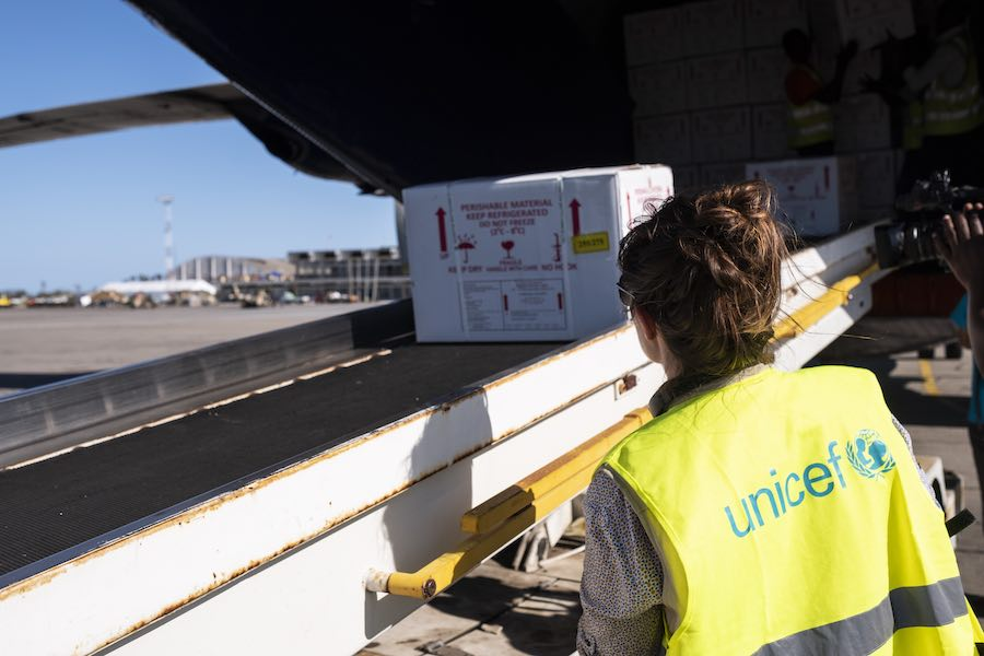 2 April 2019. A UNICEF employee watches as cholera vaccines are loaded from the cargo plane to a truck. A cargo plane arrived at Beira Airport with 900 000 cholera vaccines on board. These vaccines were provided by UNICEF and a vaccination campaign will s