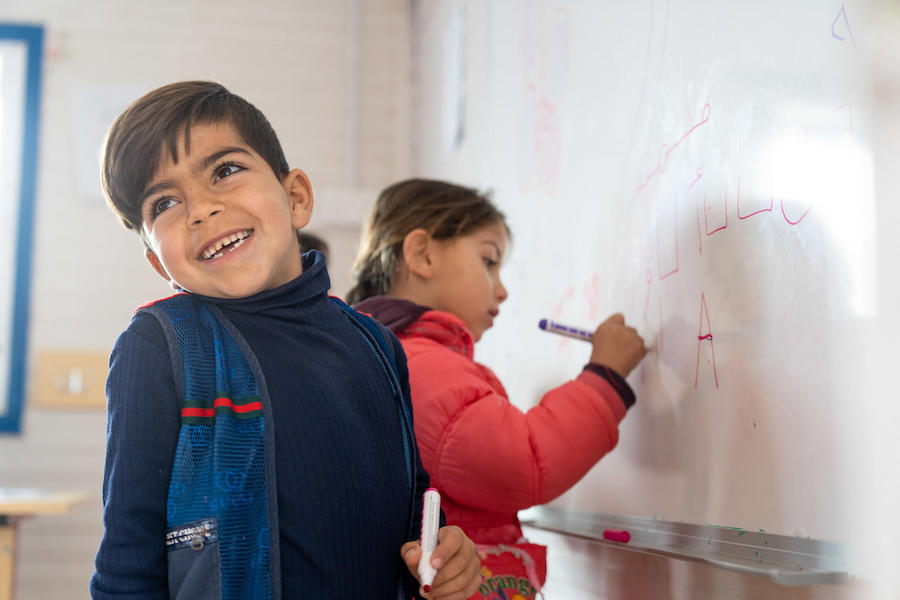 Mohammad and classmates are learning letters and numbers in their UNICEF-supported kindergarten class at Za'atari Refugee Camp in Jordan in 2019.