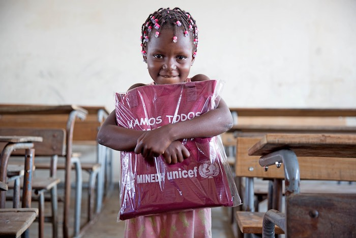 On 11 April 2019 in Beira, Mozambique, Nilda Alberta Massuve, 6, receives her education pack. UNICEF and partners distributed educations packs to learners at 12 Outobro Primary School. The school was severely damaged by Cyclone Idai.   UNICEF is ramping u