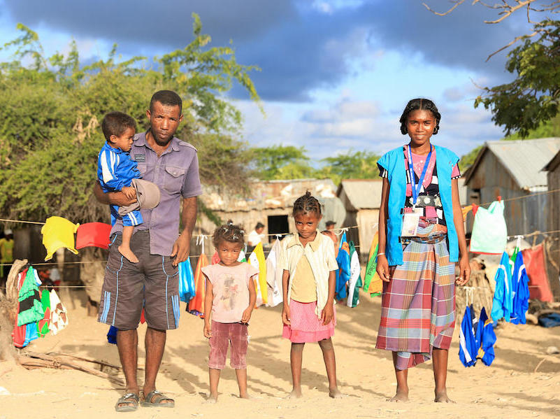 Zeme, seen here with her husband and three children, works as a UNICEF-trained Mother Leader in Tanandava, Madagascar.