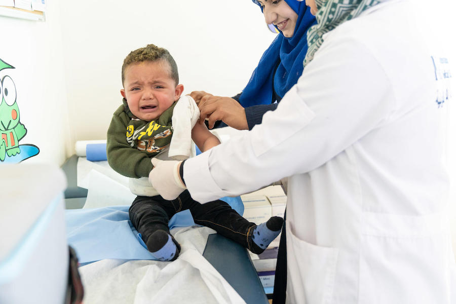 In Jordan's Azraq refugee camp in 2019, 1-year-old Mohammad receives his masles, mumps and rubella vaccination from UNICEF-supported health workers.