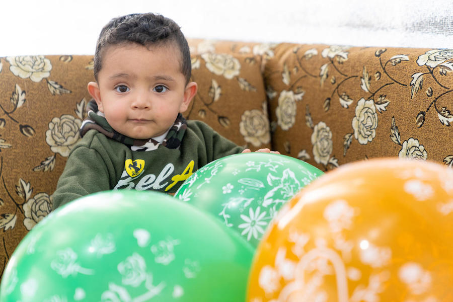 Baby Mohammad celebrated his first birthday at Azraq refugee camp in Jordan. He received his latest vaccination in one of the camp's UNICEF-supported health centers.