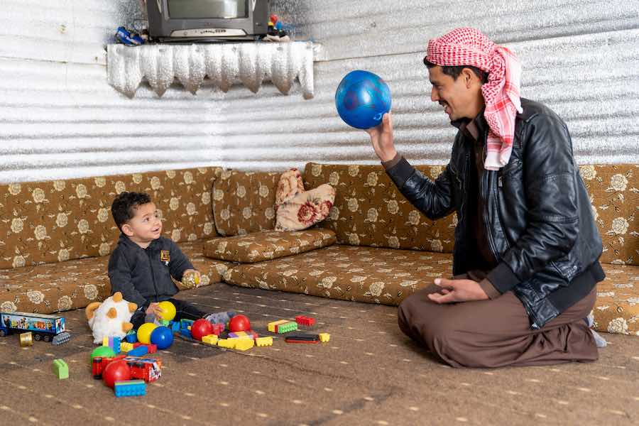"Shaheen knows the importance of play for his son's development. ""When a father plays with his child, then the child gets to know their father and learns from him. We must play with them."""