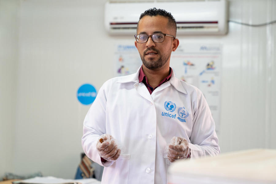 Children in this UNICEF-supported health clinic in Jordan's Azraq Refugee Camp receive vaccinations from Dr Almanti, the Ministry of Health coordinator.