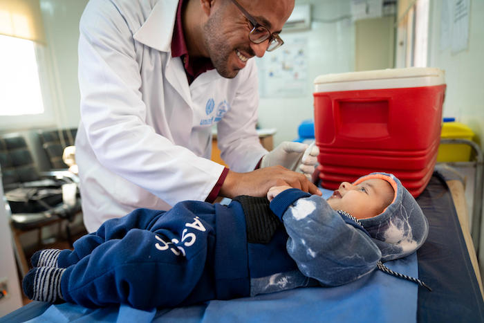 In Jordan's Azraq Refugee Camp, a UNICEF-supported doctor vaccinates 4-month-old Malek, whose family fled Syria three years ago.