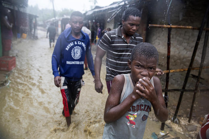 On April 28, 2019, a boy walks through flood waters during heavy rains in the Shibaburi area of Pemba, Mozambique in the wake of Cyclone Kenneth.