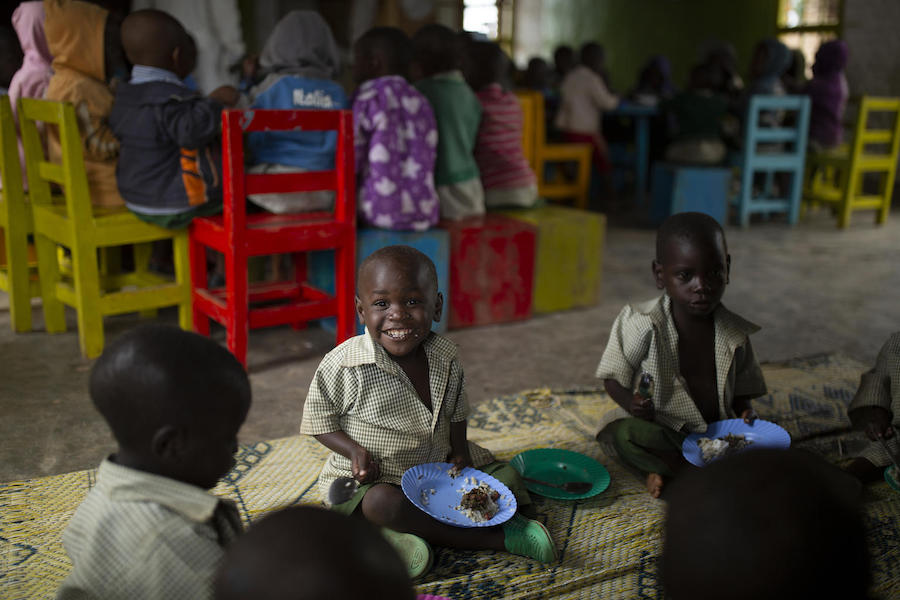 Alfonse, 2, has a hot, balanced meal at the UNICEF-supported Early Childhood Development center in Nyamiyaga Village, Northern Province, Rwanda on November 20, 2018.