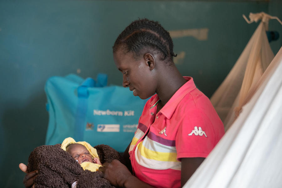 Longom Esther holds her newborn at Kaabong Hospital in northern Uganda on April 3, 2019. She received a newborn care kit provided by UNICEF with funding from KOICA.