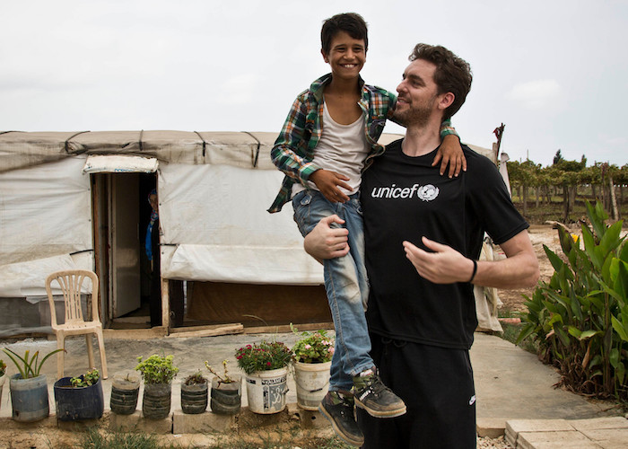 UNICEF Spain Ambassador Pau Gasol plays with Hussein, an 11-year-old Syrian refugee, in the informal settlement of Minyara, Lebanon in 2016.