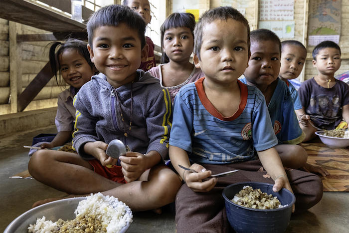 UNICEF helps make sure preschool children get a nutritious meal during their lunch break at Tahouak Primary School, Ta Oi District, Saravane Province, Laos.