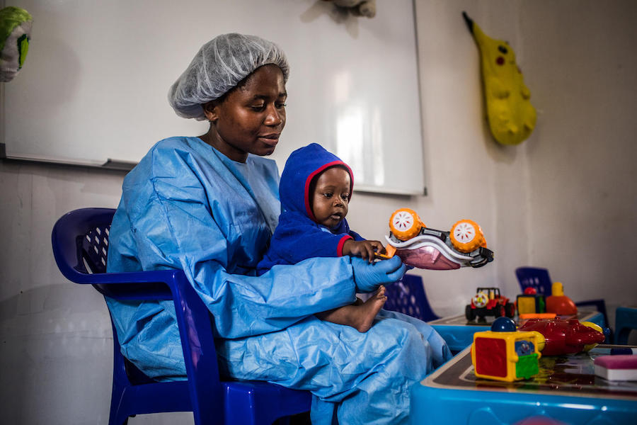 Ruth Lafleussante plays with Christ-Vie, 7 months, inside the UNICEF-supported Ebola nursery for babies and young children affected by the virus in Butembo, North Kivu, Democratic Republic of Congo, 23 March 2019.