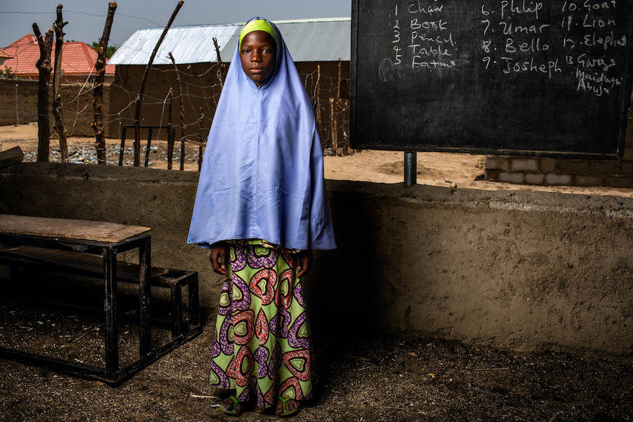Hawa, 12, stands in an open-air classroom at Sabo Garawi Primary School in Gwoza, northeast Nigeria.