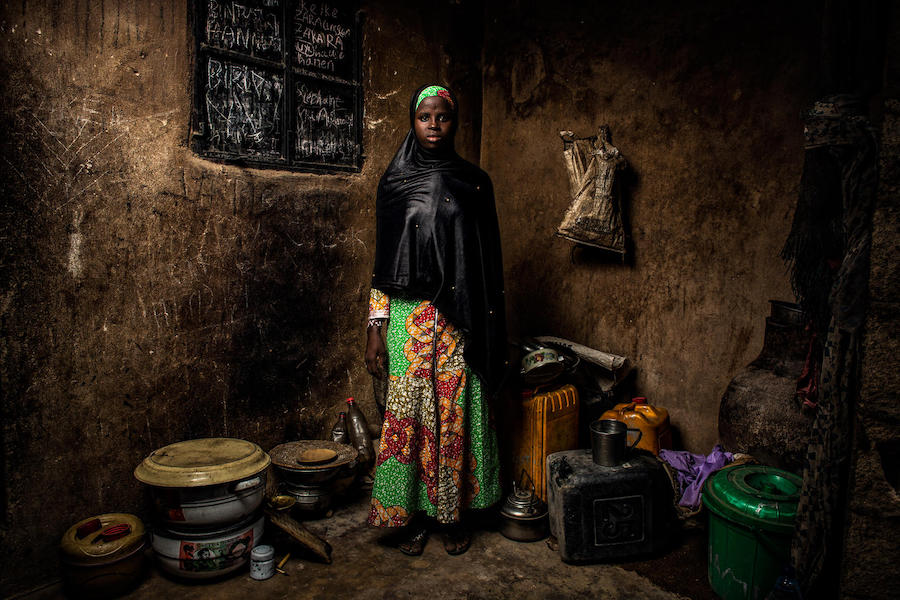 Bintu, 13, stands in her home in Banki, northeast Nigeria, on May 1, 2019. Her home village was attacked four years ago and her school was destroyed.
