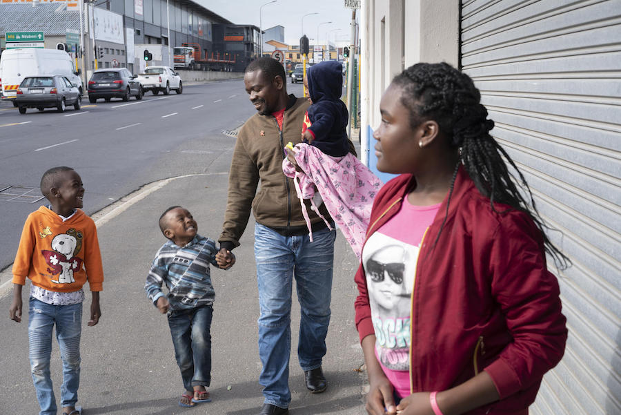 Dieu-Merci Matala, 44, walks home from the park with his children in Maitland, Cape Town, South Africa in May 2019.