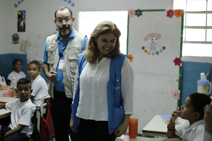 On June 4, 2019, UNICEF Director of Communication Paloma Escudero (center) and UNICEF Education Officer Dario Moreno meet with students at a UNICEF-supported school in Barrio Union, Petare, on the outskirts of Caracas, Venezuela.