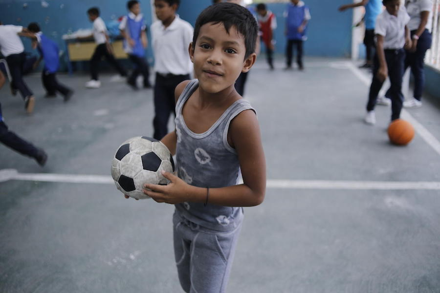 UNICEF provides recreational and educational kits for children who attend El Carmen, a school in Barrio Union, Petare, on the outskirts of Caracas.