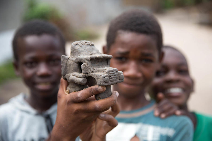 In April 2019, a boy made a truck out of clay at a school being used to shelter people displaced by Cyclone Idai in Beira, Mozambique.