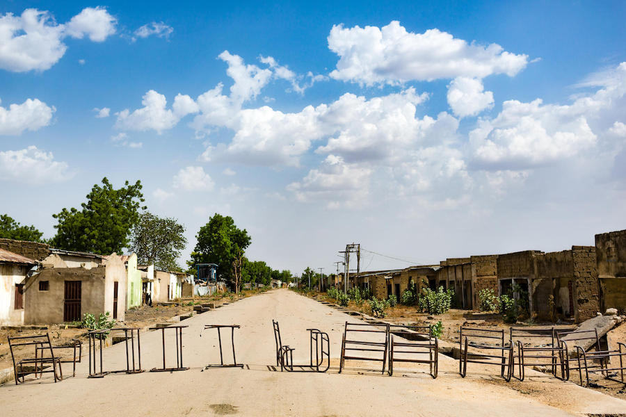A row of old desks lie across the road on the outskirts of Banki town in northeast Nigeria in May 2019. Homes, shops and schools are deserted due to insecurity in the region.