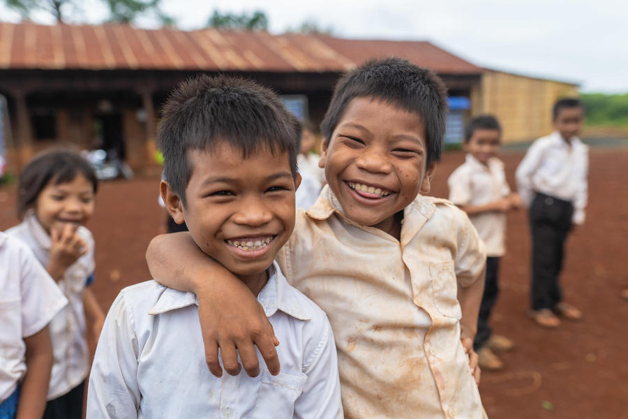 Happy friends at Thouy Ampil Primary School in Thouy Ampil Village, Ja Oung Commune, O'chum District, Ratanakiri Province, Cambodia in May 2019.