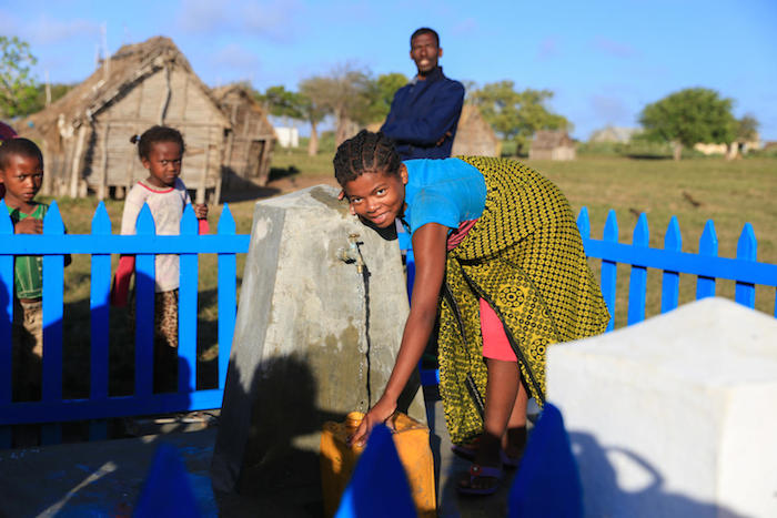 A girl in Southern Madagascar taps into her community's new source of safe water.
